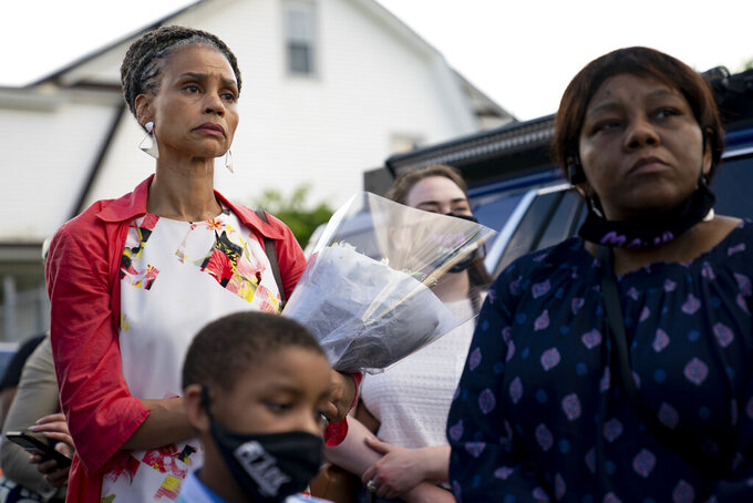 New York City mayoral candidate Maya Wiley attends a vigil at the scene where 10-year old Justin Wallace was shot and killed the previous Saturday night in the Rockaway section of the Queens borough of New York, Wednesday, June 9, 2021. Police arrested Jovan Young on Tuesday in connection with the death. Young, 29, was facing charges including murder, attempted murder and assault. (AP Photo/John Minchillo)
