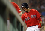Boston Red Sox's Mookie Betts celebrates at the dugout after hitting a solo home run during the eighth inning of the team's baseball game against the Baltimore Orioles at Fenway Park, Friday, Aug. 16, 2019, in Boston. (AP Photo/Elise Amendola)