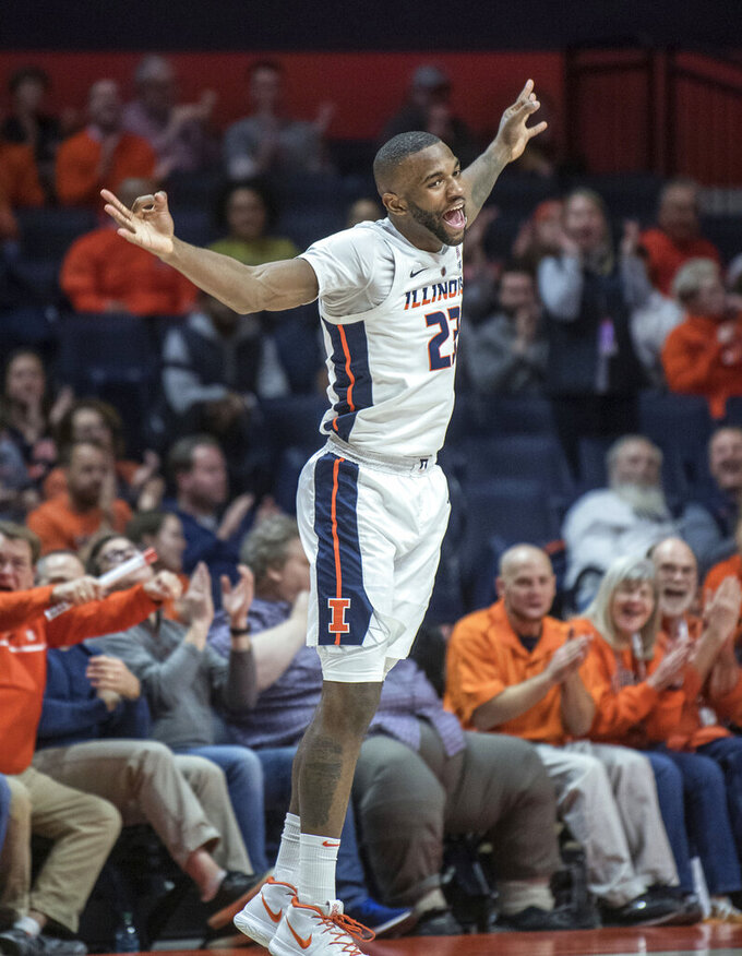 Illinois guard Aaron Jordan dances back to play defense after making a 3-point shot during the second half of the team's NCAA college basketball game against Minnesota in Champaign, Ill., Wednesday, Jan. 16, 2019. (AP Photo/Rick Danzl)