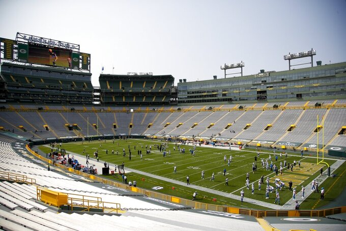 Players warm up before an NFL football game between the Green Bay Packers and the Detroit Lions Sunday, Sept. 20, 2020, in Green Bay, Wis. (AP Photo/Matt Ludtke)