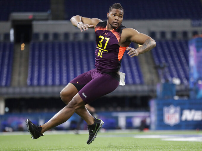 FILE - In this March 3, 2019, file photo, Michigan defensive lineman Rashan Gary runs a drill at the NFL football scouting combine, in Indianapolis. Gary is a possible pick in the 2019 NFL Draft. (AP Photo/Michael Conroy, File)