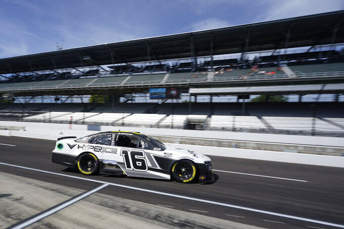 AJ Allmendinger drives on pit lane during practice for the NASCAR Cup Series at Indianapolis Motor Speedway, Saturday, Aug. 14, 2021, in Indianapolis. (AP Photo/Darron Cummings)