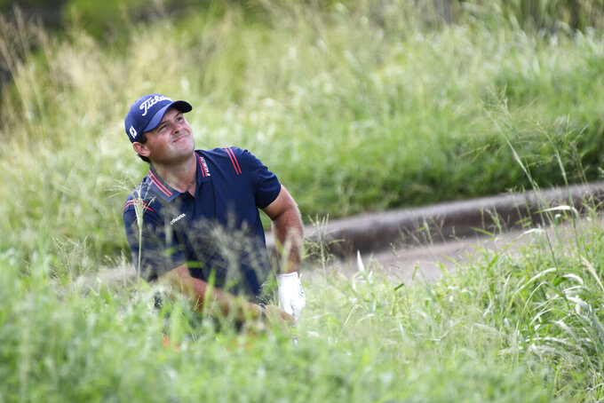 Patrick Reed watches his shot from the rough onto the ninth green during the third round of the Tournament of Champions golf event, Saturday, Jan. 9, 2021, at Kapalua Plantation Course in Kapalua, Hawaii. (Matthew Thayer/The Maui News via AP)
