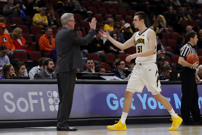 Iowa head coach Fran McCaffery gives high five to Nicholas Baer (51) during the second half of an NCAA college basketball game against the Illinois in the second round of the Big Ten Conference tournament, Thursday, March 14, 2019, in Chicago. Iowa won 83-62. (AP Photo/Nam Y. Huh)