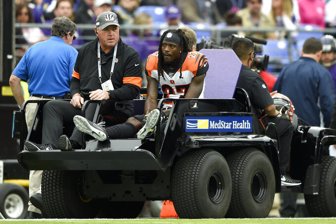 Cincinnati Bengals cornerback Dre Kirkpatrick (27) sits on the back of a cart while being taking off the field after an injury against the Baltimore Ravens during the first half of a NFL football game Sunday, Oct. 13, 2019, in Baltimore. (AP Photo/Gail Burton)