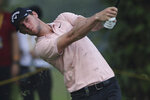 Thomas Pieters of Belgium plays his shot on the 10th hole at the Malaysia Golf Championship Round One in Kuala Lumpur, Malaysia, Thursday, March 21, 2019. (AP Photo/Vincent Phoon)