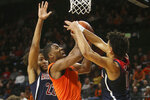 Oregon State's Alfred Hollins, center, goes up for a shot between Arizona's Zeke Nnaji, left, and Josh Green during the second half of an NCAA college basketball game in Corvallis, Ore., Sunday, Jan. 12, 2020. (AP Photo/Chris Pietsch)