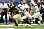 Colorado wide receiver Dimitri Stanley (14) runs past Texas defensive back D'Shawn Jamison (5) after a catch during the first half of the Alamo Bowl NCAA college football game Tuesday, Dec. 29, 2020, in San Antonio. (AP Photo/Eric Gay)