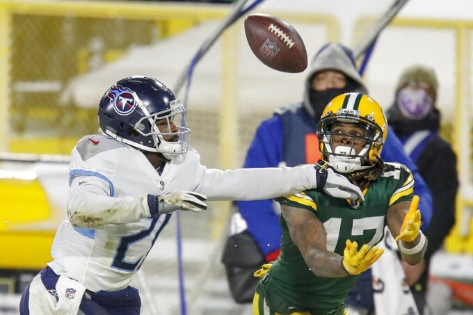 Green Bay Packers' Davante Adams catches a pass in front of Tennessee Titans' Malcolm Butler during the second half of an NFL football game Sunday, Dec. 27, 2020, in Green Bay, Wis. (AP Photo/Matt Ludtke)
