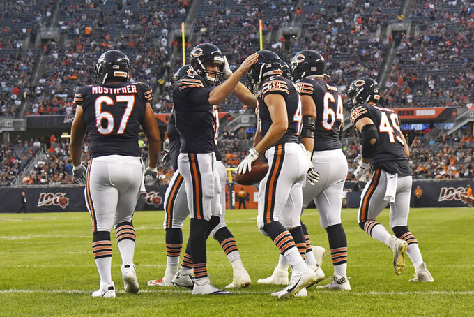Chicago Bears quarterback Tyler Bray (9) and tight end Jesper Horsted (47) celebrates after Horsted caught a touchdown pass during the first half of an NFL preseason football game against the Tennessee Titans on Thursday, Aug. 29, 2019, in Chicago. (AP Photo/David Banks)