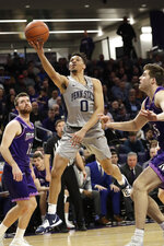Penn State guard Myreon Jones (0) drives to the basket against Northwestern during the first half of an NCAA college basketball game in Evanston, Ill., Saturday, March 7, 2020. (AP Photo/Nam Y. Huh)