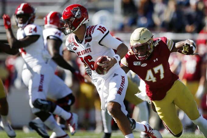 Boston College defensive end Shitta Sillah (47) sacks North Carolina State quarterback Bailey Hockman (16) during the first half of an NCAA college football game in Boston, Saturday, Oct. 19, 2019. (AP Photo/Michael Dwyer)