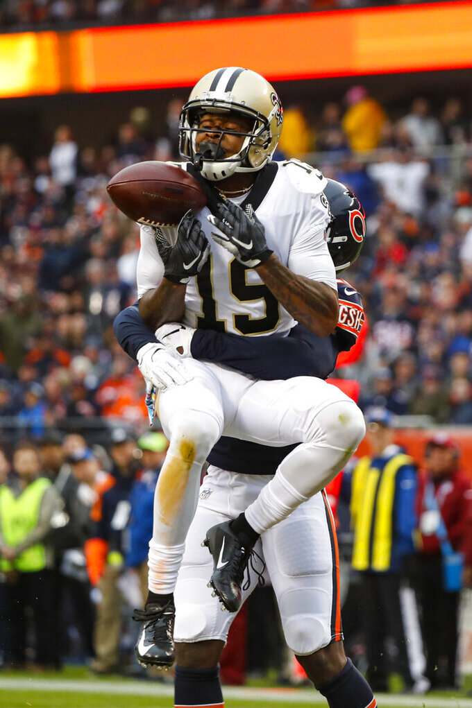 New Orleans Saints wide receiver Ted Ginn (19) drops a pass in the end zone as he's hit by Chicago Bears cornerback Prince Amukamara (20) during the first half of an NFL football game in Chicago, Sunday, Oct. 20, 2019. (AP Photo/Charles Rex Arbogast)