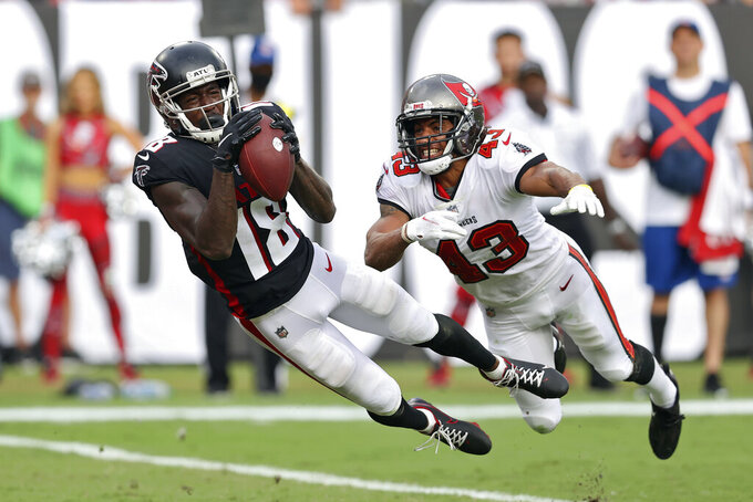 """FILE - Atlanta Falcons wide receiver Calvin Ridley (18) makes a diving touchdown reception in front of Tampa Bay Buccaneers defensive back Ross Cockrell (43) during the second half of an NFL football game in Tampa, Fla., in this Sunday, Sept. 19, 2021, file photo. Matt Ryan is looking to see the Atlanta Falcons' offense continue its improvement when the team returns from its bye week for Sunday's game in Miami. Having top target Calvin Ridley back in the lineup should help the offense. Ryan said Wednesday, Oct. 20, 2021, Ridley """"was flying around"""" in his return to practice after missing the Falcons' last game for personal reasons. (AP Photo/Mark LoMoglio, File)"""
