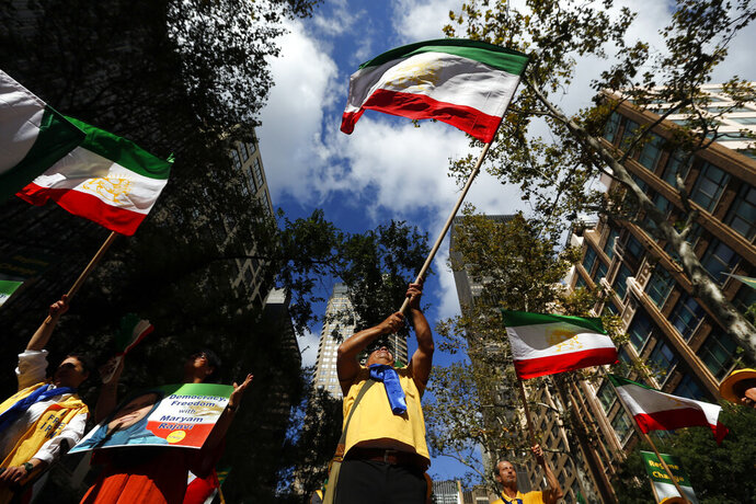 Supporters of a regime change in Iran rally outside United Nations headquarters on the first day of the general debate at the U.N. General Assembly, Tuesday, Sept. 24, 2019, in New York. (AP Photo/Jason DeCrow)