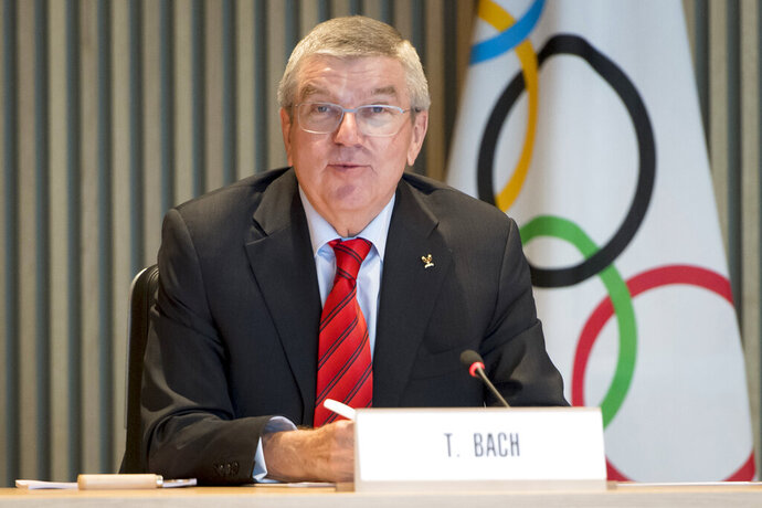 FILE - In this Oct. 2, 2019, file photo, International Olympic Committee president Thomas Bach speaks at the opening of the executive board meeting of the IOC at the Olympic House in Lausanne, Switzerland. The incoming leader of the World Anti-Doping Agency asked for more money. The International Olympic Committee said `yes.' IOC president Thomas Bach pledged $10 million to fight doping in sports, half of which would go toward storing samples from pre-Olympics testing for 10 years and the other half toward investigations and research. (Laurent Gillieron/Keystone via AP, File)