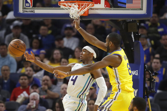 Charlotte Hornets guard Devonte' Graham (4) passes the ball as he is defended by Golden State Warriors guard Alec Burks during the second half of an NBA basketball game in San Francisco, Saturday, Nov. 2, 2019. (AP Photo/Jeff Chiu)