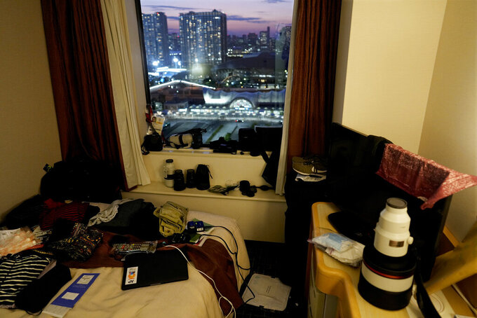 Associated Press photographer Natacha Pisarenko's gear and clothes sit in her room at the Tokyo Bay Washington Bay Ariake Hotel on Monday, July 19, 2021. (AP Photo/Natacha Pisarenko)