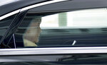 German Chancellor Angela Merkel looks at a mobile device as she leaves the headquarters of the German Christian Democratic Party (CDU) in a car in Berlin, Germany, Monday, Sept. 13, 2021. (AP Photo/Michael Sohn)