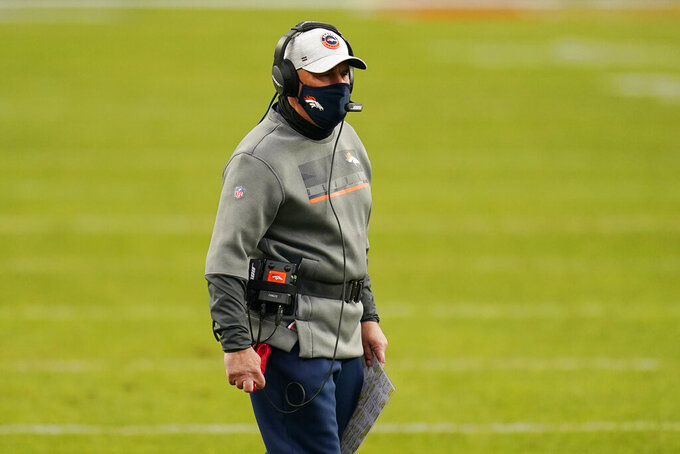 Denver Broncos head coach Vic Fangio watches during the first half of an NFL football game against the Las Vegas Raiders, Sunday, Jan. 3, 2021, in Denver. (AP Photo/Jack Dempsey)