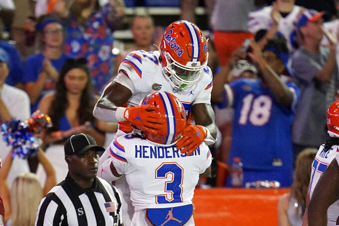 Florida running back Dameon Pierce, top celebrates a touchdown run against Florida Atlantic with wide receiver Xzavier Henderson (3) during the second half of an NCAA college football game Saturday, Sept. 4, 2021, in Gainesville, Fla. (AP Photo/John Raoux)