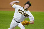 San Diego Padres' Garrett Richards delivers against the Los Angeles Dodgers during the eighth inning in Game 3 of a baseball National League Division Series Thursday, Oct. 8, 2020, in Arlington, Texas. (AP Photo/Tony Gutierrez)