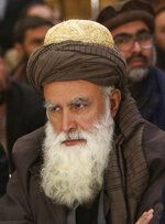 FILE - In this Dec. 18, 2015 photo, former Afghan warlord Abdul Rasool Sayyaf, attends the Afghanistan Protection and Stability Council in Kabul, Afghanistan. On April 29, 2019, President Ashraf Ghani stressed the importance of