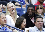 FILE - In this Sept. 8, 2019, file photo, Lindsey Vonn, left, and P.K. Subban talk with friends during the men's singles final of the U.S. Open tennis championships in New York. Subban and the NHL are bringing something new to television Saturday for fans and everyone dealing with the isolation and hardships caused by the coronavirus pandemic. Everything is filmed remotely with Subban hosting the show from his living room in Los Angeles in the house he shares with fiancee and Olympic gold medalist Lindsey Vonn. (AP Photo/Adam Hunger, File)