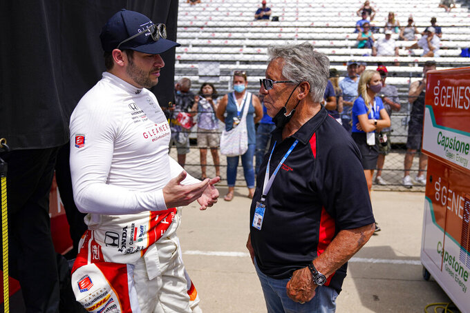 Marco Andretti, left, talks with his grandfather and Indianapolis 500 champion Mario Andretti during practice for the Indianapolis 500 auto race at Indianapolis Motor Speedway in Indianapolis, Friday, May 21, 2021. (AP Photo/Michael Conroy)