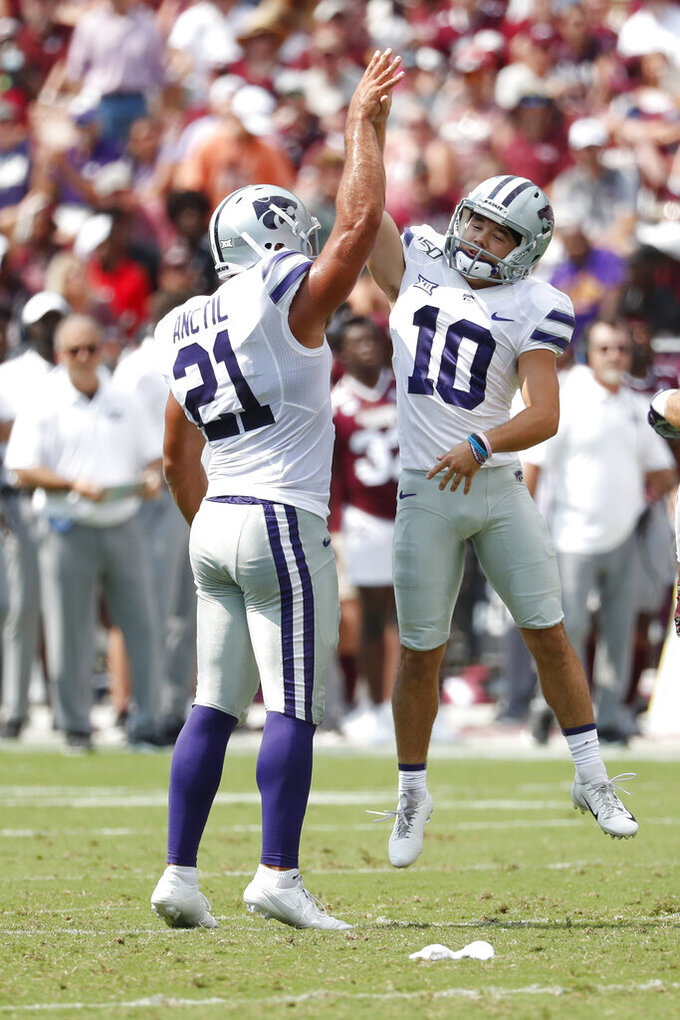 Kansas State place kicker Blake Lynch (10) and holder Devin Anctil (21) celebrate Lynch's 35-yard field goal during the first half of their NCAA college football game in Starkville, Miss., Saturday, Sept. 14, 2019. (AP Photo/Rogelio V. Solis)
