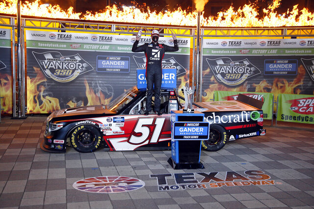 Kyle Busch celebrates in Victory Lane after winning a NASCAR Trucks race at Texas Motor Speedway in Fort Worth, Texas, Saturday, July 18, 2020. (AP Photo/Ray Carlin)
