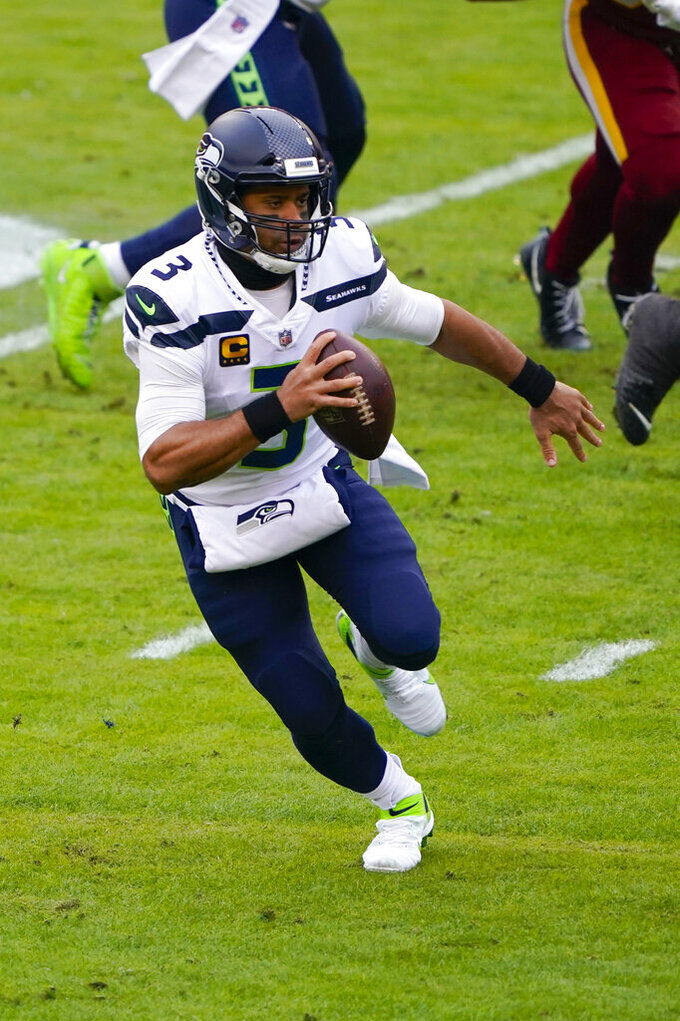 Seattle Seahawks quarterback Russell Wilson (3) runs with the ball during the first half of an NFL football game against the Washington Football Team, Sunday, Dec. 20, 2020, in Landover, Md. (AP Photo/Mark Tenally)