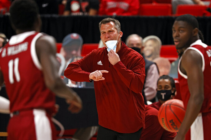 Troy coach Scott Cross yells out to his team during the first half of an NCAA college basketball game against Texas Tech, Friday, Dec. 4, 2020, in Lubbock, Texas. (AP Photo/Brad Tollefson)