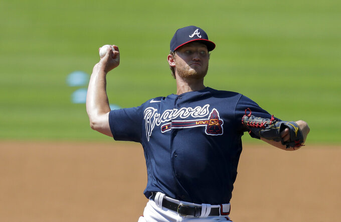 Atlanta Braves' Mike Soroka throws during team baseball practice at Truist Park on Friday, July 3, 2020, in Atlanta. (AP Photo/Brynn Anderson)