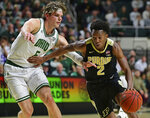 Purdue guard Eric Hunter Jr. drives on Ohio forward Ben Vander Plas during the first half of an NCAA college basketball game, Tuesday, Dec. 17, 2019, in Athens, Ohio. (AP Photo/David Dermer)