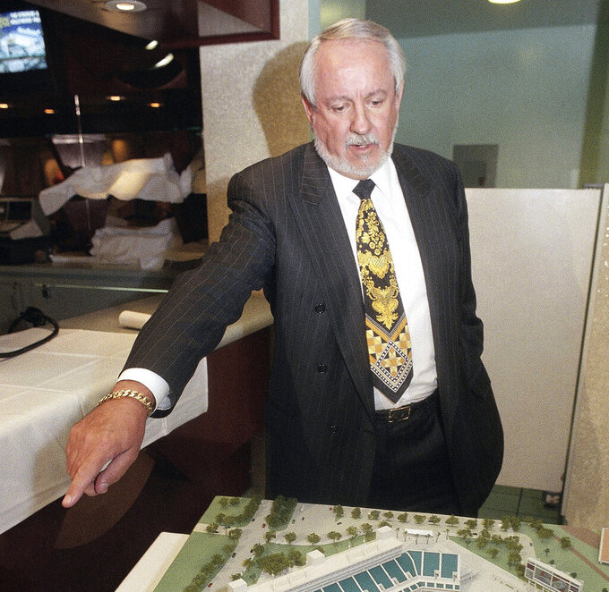 FILE - In this Dec. 8, 1995, file photo, Hollywood Park Chairman and Chief Operating Officer R.D. Hubbard shows off a model of a proposed NFL stadium to be built on Hollywood Park's property adjacent to the existing race track following a news conference in Inglewood, Calif. Hubbard, who bred, owned and raced thoroughbred and quarter horses, and was an influential executive in the racing industry, has died. He was 84. (AP Photo/Chris Pizzello)