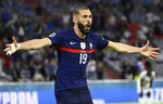 France's Karim Benzema runs to celebrate scoring a goal that was overturned for an offside during the Euro 2020 soccer championship group F match between Germany and France at the Allianz Arena stadium in Munich, Tuesday, June 15, 2021. (Franck Fife/Pool via AP)