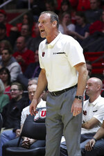 Utah coach Larry Krystkowiak calls a play against Oregon from the sidelines during the first half of an NCAA college basketball game, Thursday, Jan. 31, 2019, in Salt Lake City. (AP Photo/Chris Nicoll)