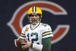 Green Bay Packers' Aaron Rodgers looks to pass during the second half of an NFL football game against the Chicago Bears Sunday, Jan. 3, 2021, in Chicago. (AP Photo/Nam Y. Huh)