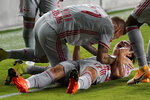 New York Red Bulls midfielder Ben Mines, right, celebrates with Daniel Royer after scoring a goal during the second half of an MLS soccer match against Inter Miami, Wednesday, Sept. 23, 2020, in Fort Lauderdale, Fla. The New York Red Bulls won 4-1. (AP Photo/Lynne Sladky)