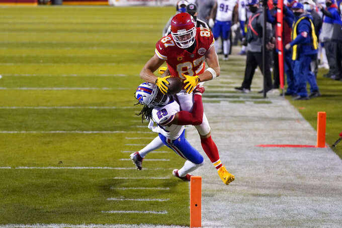 Kansas City Chiefs tight end Travis Kelce (87) dives toward the goal line over Buffalo Bills cornerback Josh Norman (29) during the first half of the AFC championship NFL football game, Sunday, Jan. 24, 2021, in Kansas City, Mo. Kelce was ruled out of bounds on the play. (AP Photo/Jeff Roberson)