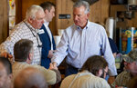 U.S. Senate candidate Tommy Tuberville, right, makes a stop at Martin's Restaurant in Montgomery, Ala., on Monday, Feb. 13, 2020, to kick off a month-long bus campaign in the state. (Mickey Welsh/Montgomery Advertiser via AP)