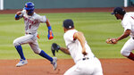 New York Mets' Amed Rosario (1) dashes away from Boston Red Sox pitcher Josh Osich, center, and shortstop Xander Bogaerts while trying to advance to third during the first inning of a baseball game, Monday, July 27, 2020, at Fenway Park in Boston. Rosario was out on the play. (AP Photo/Charles Krupa)