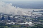 A chemical fire burns at a facility during the aftermath of Hurricane Laura Thursday, Aug. 27, 2020, near Lake Charles, La. (AP Photo/David J. Phillip)