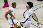 Illinois' Adam Miller, left, and Andre Curbelo celebrate during the second half of the team's NCAA college basketball game against Rutgers at the Big Ten Conference men's tournament in Indianapolis, Friday, March 12, 2021. (AP Photo/Michael Conroy)