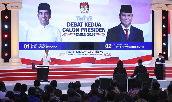 Indonesian presidential candidate Joko Widodo, left, deliver his speech and his contender Prabowo Subianto, right, listen during a televised debate in Jakarta, Indonesia, Sunday, Feb. 17, 2019.  Indonesia is gearing up to hold its presidential election on April 17 that will pit in the incumbent against the former general. (AP Photo / Achmad Ibrahim)