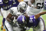 Oakland Raiders running back Josh Jacobs (28) is tackled by Minnesota Vikings middle linebacker Eric Kendricks (54) during the second half of an NFL football game, Sunday, Sept. 22, 2019, in Minneapolis. (AP Photo/Jim Mone)