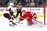 Detroit Red Wings goaltender Jonathan Bernier (45) blocks an Ottawa Senators' Artem Anisimov (51) shot during a shootout in an NHL hockey game Friday, Jan. 10, 2020, in Detroit. (AP Photo/Paul Sancya)