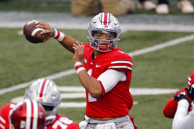FILE - Ohio State quarterback Justin Fields throws a pass against Indiana during the first half of an NCAA college football game in Columbus, Ohio, in this Saturday, Nov. 21, 2020, file photo. Fields threw a Sugar Bowl-record six touchdown passes and accumulated 385 yards passing in the third-ranked Buckeyes' 49-28 College Football Playoff semifinal victory over No. 2 Clemson. (AP Photo/Jay LaPrete, File)
