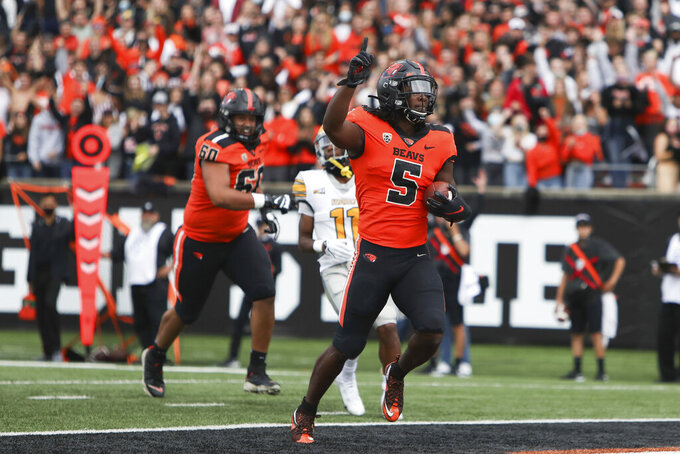 Oregon State running back Deshaun Fenwick (5) scores a touchdown during the first half of an NCAA college football game against Idaho on Saturday, Sept. 18, 2021, in Corvallis, Ore. (AP Photo/Amanda Loman)